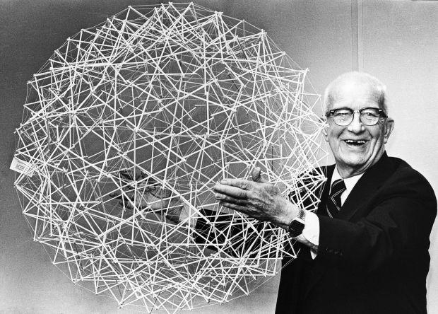 Buckminister Fuller holding geodesic tensegrity sphere